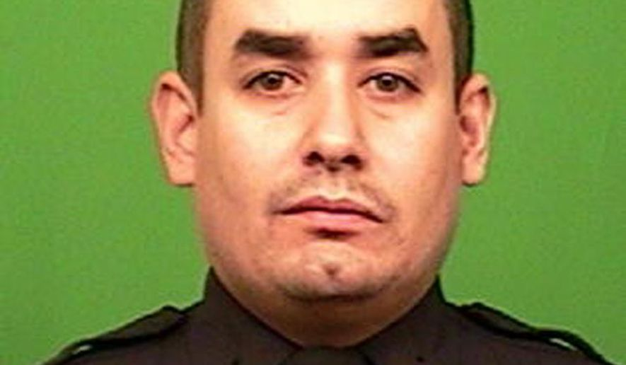 This photo provided by the New York Police Department shows officer Rafael Ramos. Ramos and officer Wenjian Liu were shot and killed Saturday, Dec. 20, 2014, in the Brooklyn borough of New York. The suspect, 28-year-old Ismaaiyl Brinsley, ran to a subway station and killed himself. (AP Photo/New York Police Department)