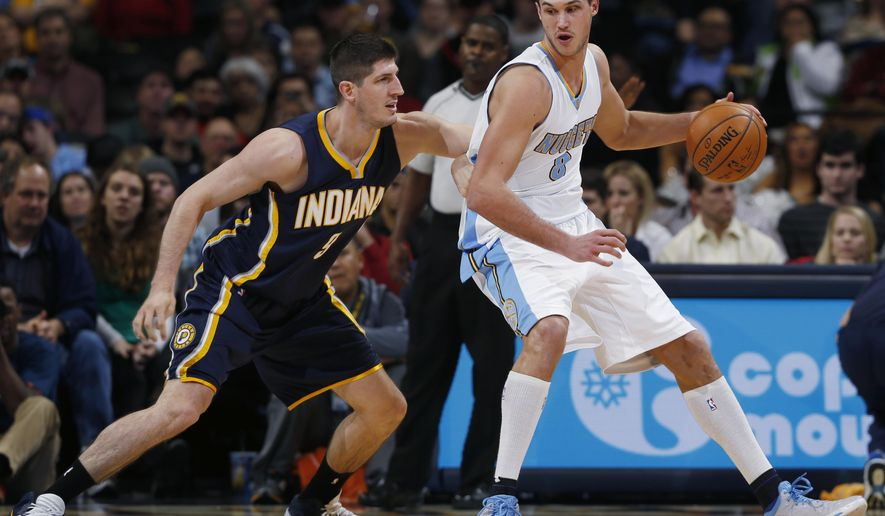Indiana Pacers forward Damjan Rudez, left, of Croatia, blocks Denver Nuggets forward Danilo Gallinari, of Italy, as he tries to work the ball inside for a shot in the third quarter of an NBA basketball game Saturday, Dec. 20, 2014, in Denver. The Nuggets won 76-73. (AP Photo/David Zalubowski)