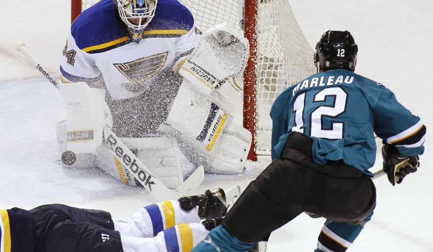 St. Louis Blues goalie Jake Allen blocks the puck hit by San Jose Sharks' Patrick Marleau during the first period of an NHL hockey game, Saturday, Dec. 20, 2014, in San Jose, Calif. (AP Photo/George Nikitin)