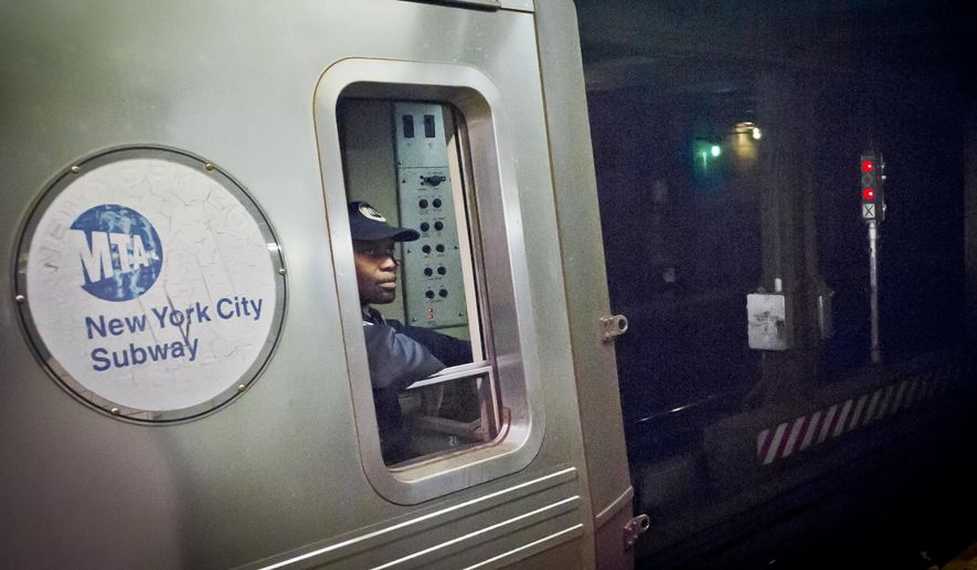 In this Dec. 16, 2014, photo, a Metropolitan Transit Authority subway train operator waits for red-light signal, controlled by a manual subway interlocking switch and signal system, to go green, in New York. (AP Photo/Bebeto Matthews) ** FILE **
