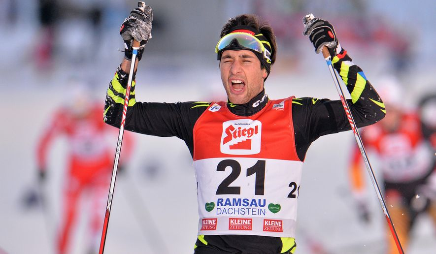 France's winner Jason Lamy Chappuis celebrates in the finish area after the Nordic Combined World Cup competition in Ramsau, Austria, on Sunday, Dec. 21, 2014. (AP Photo/Kerstin Joensson)