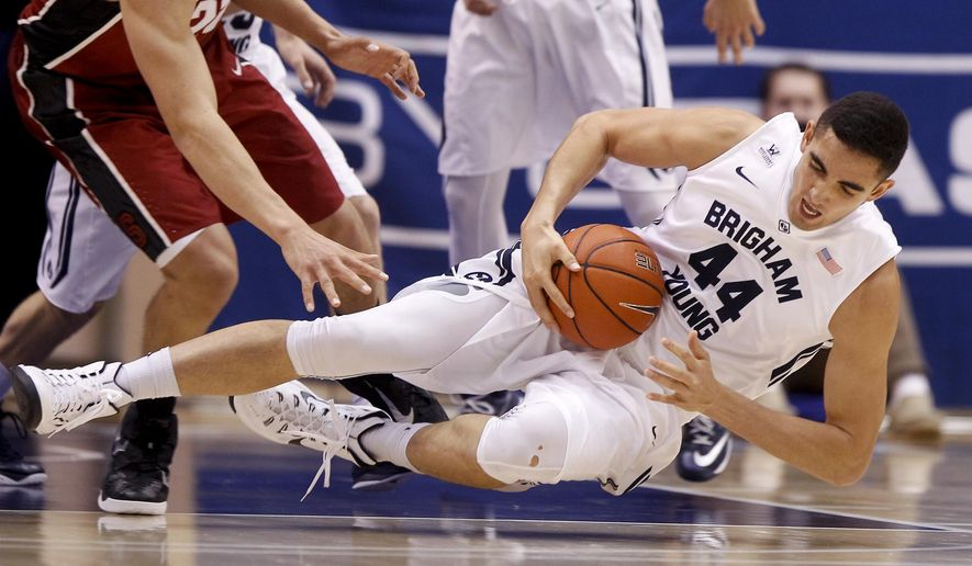 BYU center Corbin Kaufusi (44) falls to the ground while securing a loose ball during BYU's NCAA college basketball game against Stanford on Saturday, Dec. 20, 2014, in Provo, Utah. (AP Photo/Daily Herald, Ian Maule)