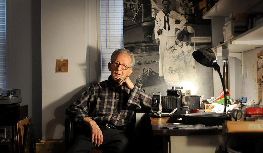 In this Dec. 9, 2014 photo, Herman Schnipper, 91, who was a NAVY photographer aboard the USS Astoria during WWII, poses for a photograph at his home in Hackensack, N.J. (AP Photo/Northjersey.com,  Mitsu Yasukawa) ONLINE OUT; MAGS OUT; TV OUT; INTERNET OUT;  NO ARCHIVING; MANDATORY CREDIT
