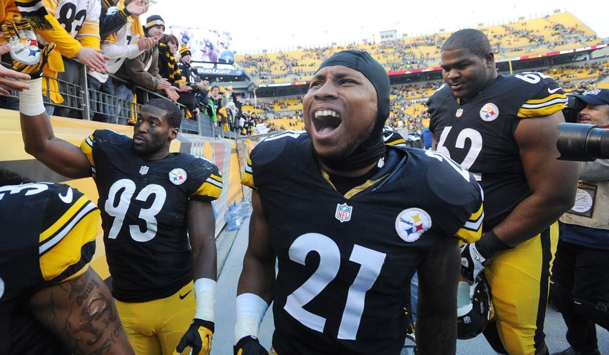 Pittsburgh Steelers safety Robert Golden (21) celebrates as he walks off the field after a 20-12 win over the Kansas City Chiefs in an NFL football game in Pittsburgh, Sunday, Dec. 21, 2014. (AP Photo/Don Wright)