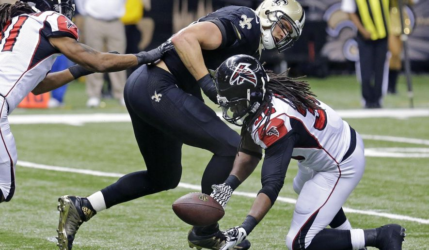 Atlanta Falcons strong safety Kemal Ishmael (36) scoops up a fumble after a reception by New Orleans Saints tight end Jimmy Graham (80) at the goal line in the second half of an NFL football game in New Orleans, Sunday, Dec. 21, 2014. Left is Falcons free safety Dezmen Southward. (AP Photo/Bill Haber)