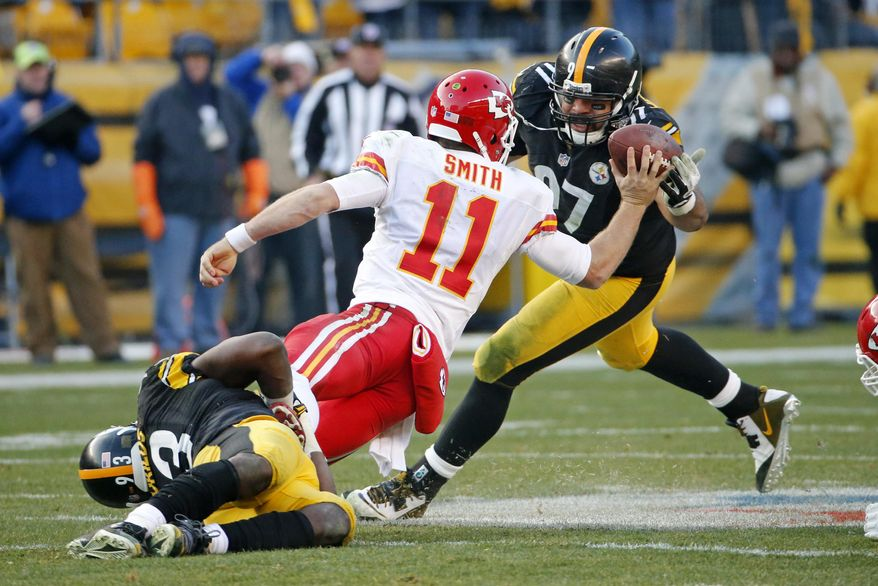 Pittsburgh Steelers defensive end Cameron Heyward (97) tips the ball out of the hand of Kansas City Chiefs quarterback Alex Smith (11) as outside linebacker Jason Worilds (93) tackles him during the second half of an NFL football game in Pittsburgh, Sunday, Dec. 21, 2014. The Steelers won 20-12. (AP Photo/Tom Puskar)