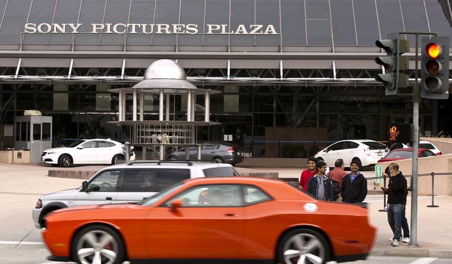 """Cars drive by the Sony Pictures Plaza building in Culver City, Calif., Friday, Dec. 19, 2014. President Barack Obama declared Friday that Sony """"made a mistake"""" in shelving the satirical film, """"The Interview,"""" about a plot to assassinate North Korea's leader. He pledged the U.S. would respond """"in a place and manner and time that we choose"""" to the hacking attack on Sony that led to the withdrawal. The FBI blamed the hack on the communist government. (AP Photo/Damian Dovarganes)"""