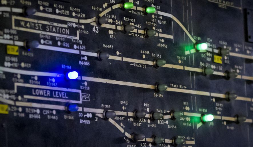 In this Dec. 16, 2014 photo, lights on a section of the MTA subway interlocking switch and signal control board shows train locations, at the 4th Street MTA Supervisory Tower in New York. Transit officials are now replacing the 1930s manual signal system with 21st century digital technology that will allow more trains to travel closer together and a growing ridership to move around the city faster. (AP Photo/Bebeto Matthews)
