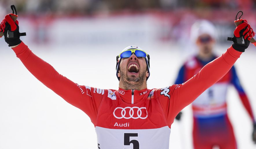 Federico Pellegrino of Italy celebrates his victory in the men's 1.3 km sprint final run at the Cross Country World Cup in Davos, Switzerland, Sunday, Dec. 21, 2014. The event has been moved from La Clusaz, France, due to lack of snow. (AP Photo/Keystone, Gian Ehrenzeller)