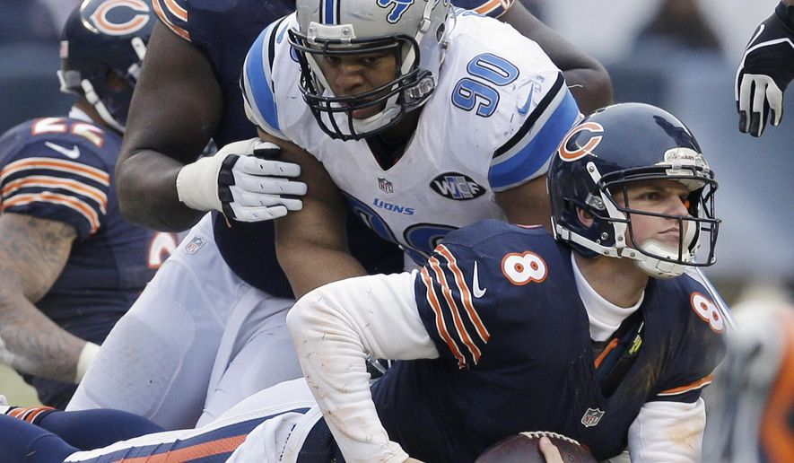 Chicago Bears quarterback Jimmy Clausen (8) is sacked by Detroit Lions defensive tackle Ndamukong Suh (90) in the second half of an NFL football game Sunday, Dec. 21, 2014, in Chicago. (AP Photo/Nam Y. Huh)