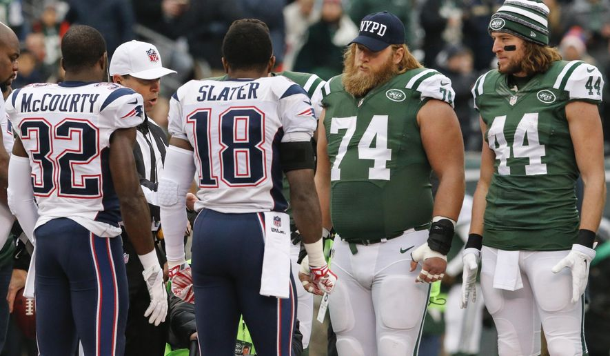 New York Jets center Nick Mangold (74) wears an NYPD cap during the coin toss with teammate Zach Sudfeld (44) and New England Patriots' Devin McCourty (32) and Matthew Slater (18) before an NFL football game Sunday, Dec. 21, 2014, in East Rutherford, N.J. (AP Photo/Julio Cortez)