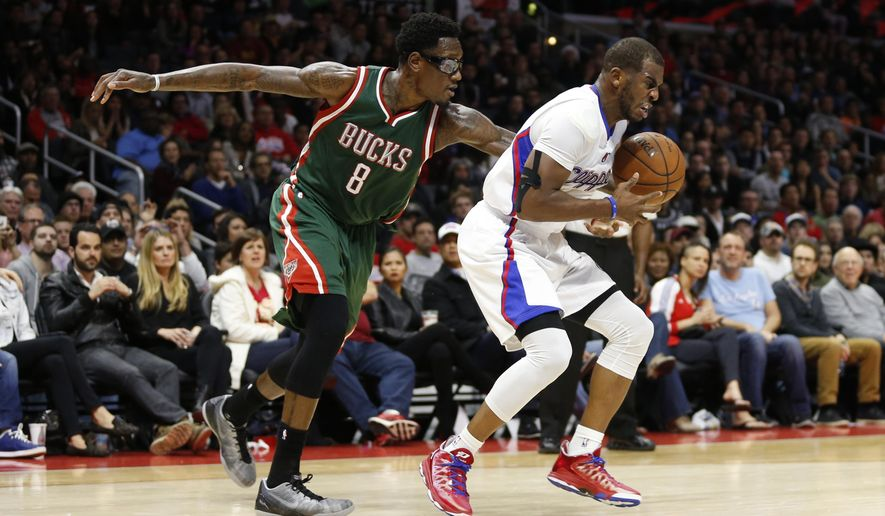 Milwaukee Bucks' Larry Sanders, left, fouls Los Angeles Clippers' Chris Paul during the second half of an NBA basketball game Saturday, Dec. 20, 2014, in Los Angeles. The Clippers won 106-102. (AP Photo/Danny Moloshok)