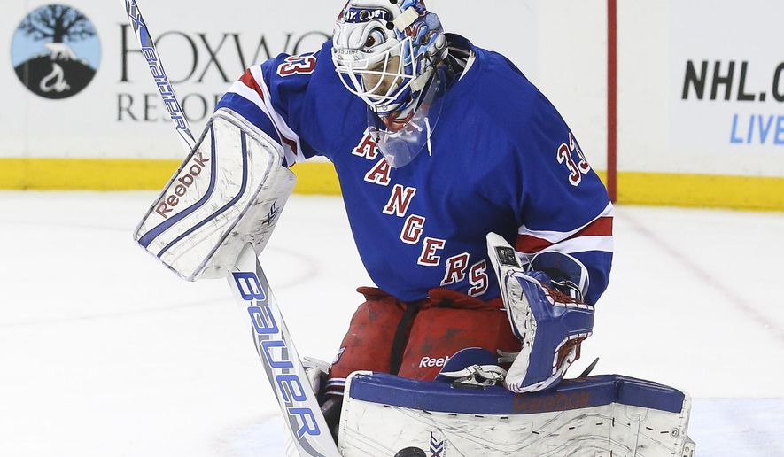 New York Rangers goalie Cam Talbot (33) makes a save in the first period of an NHL hockey game against the Carolina Hurricanes, Sunday, Dec. 21, 2014, in New York. (AP Photo/John Minchillo)