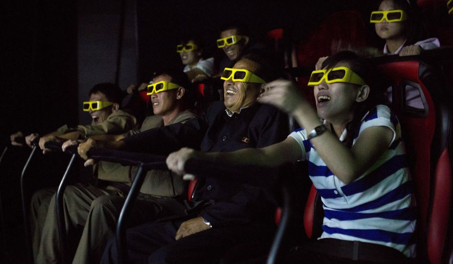 FILE - In this Sept. 22, 2013 file photo, North Koreans ride on an amusement park ride while watching a 3D movie at the Rungna People's Pleasure Park in Pyongyang, North Korea. North Korea hates the Hollywood film that revolves around the assassination of its beloved leader, but the country has had a long love affair with cinema - of its own particular styling. (AP Photo/David Guttenfelder, File)