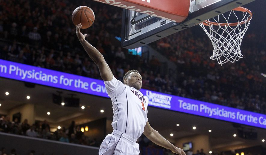 Virginia guard Justin Anderson (1) canno hold onto a pass during the first half of an NCAA college basketball game against Harvard in Charlottesville, Va., Sunday, Dec. 21, 2014. (AP Photo/Ryan M. Kelly)