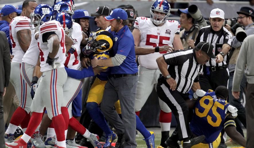 Members of the St. Louis Rams and the New York Giants fight on the sideline during the first half of an NFL football game Sunday, Dec. 21, 2014, in St. Louis. Members of both teams were ejected after the altercation. (AP Photo/Tom Gannam)