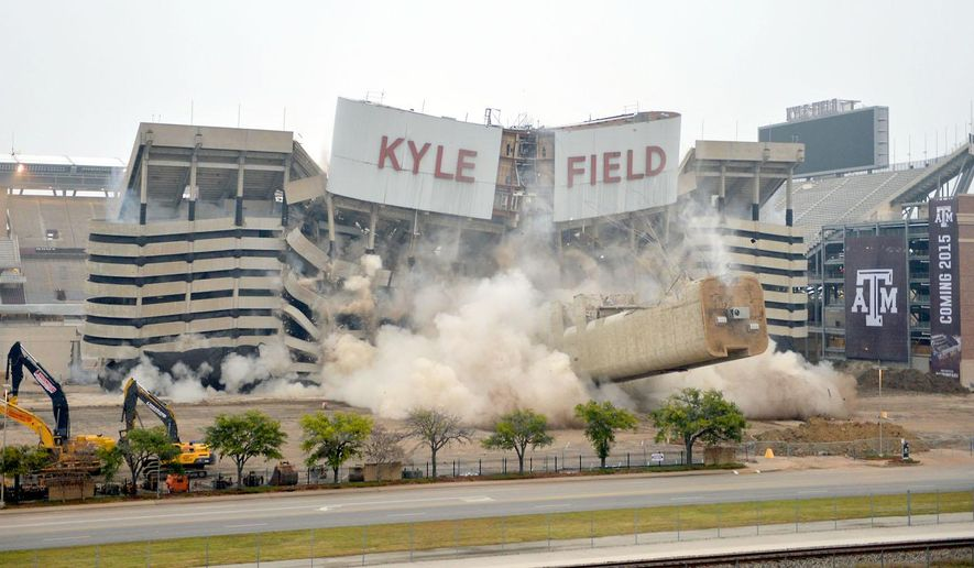 The west side of Kyle Field at Texas A&M University implodes Sunday, Dec. 21, 2014, in College Station, Texas  The section was imploded to make way for a new facade and facilities as part of a $450 million renovation. (AP Photo/College Station Eagle, Sam Craft)