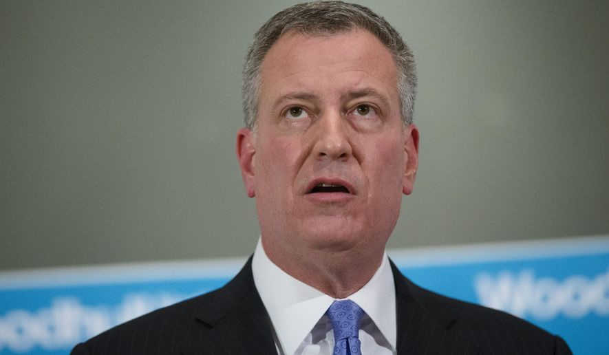 ADDS BOTH OFFICERS KILLED - New York City Mayor Bill de Blasio, speaks during a news conference at Woodhull Medical Center, Saturday, Dec. 20, 2014, in New York.  An armed man walked up to two New York Police Department officers sitting inside a patrol car and opened fire Saturday afternoon, killing both officers before running into a nearby subway station and committing suicide, police said. (AP Photo/John Minchillo)