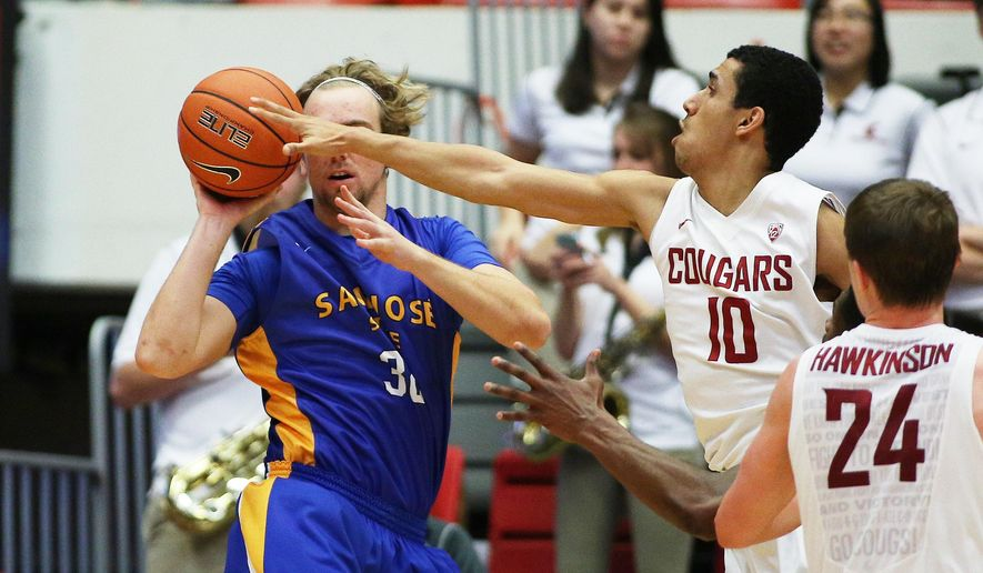 Washington State's Dexter Kernich-Drew (10) challenges a pass by San Jose State's Andrew Vollert during the second half of an NCAA college basketball game in Pullman, Wash., Sunday, Dec. 21, 2014. Washington State won 82-53. (AP Photo/Young Kwak)