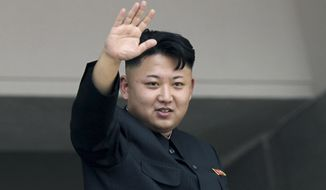 North Korea's leader Kim Jong-un waves to spectators and participants of a mass military parade celebrating the 60th anniversary of the Korean War armistice in Pyongyang, North Korea, in this July 27, 2013, file photo. (AP Photo/Wong Maye-E, File)