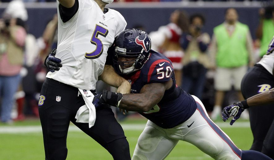 Baltimore Ravens quarterback Joe Flacco (5) passes the ball as Baltimore Ravens outside linebacker Albert McClellan (50) moves in during the first half of an NFL football game Sunday, Dec. 21, 2014, in Houston. (AP Photo/David J. Phillip)