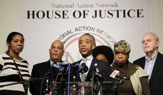 The Rev. Al Sharpton, center, speaks about Saturday's killings of two New York City police officers, Sunday, Dec. 21, 2014, during a news conference at the National Action Network headquarters, in New York. Behind him are, from left, Esaw Garner, widow of Eric Garner, attorney Michael Hardy, Gwen Carr, mother of Eric Garner, and attorney Jonathan Moore. (AP Photo/Mark Lennihan) ** FILE **