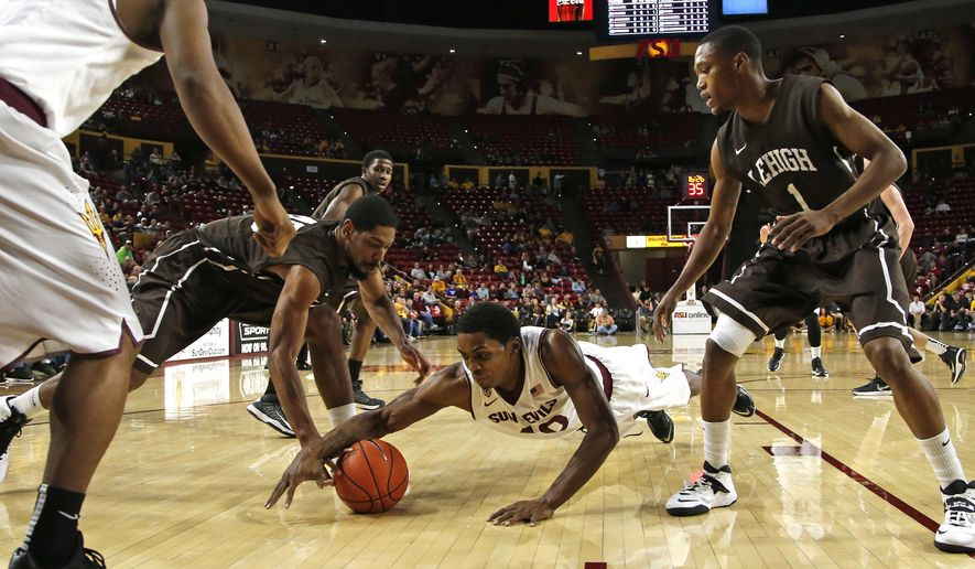 Arizona State's Shaquielle McKissic dives for the ball before Lehigh's Justin Goldsborough, left, can get it during the first half of an NCAA college basketball game in Tempe, Ariz., on Saturday, Dec. 20, 2014. (AP Photo/The Arizona Republic, Cheryl Evans)