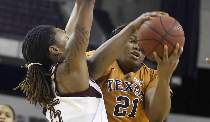 Texas' Nekia Jones (21) tries to shoot in front of Texas A&M's Achiri Ade (35) in the first half of an NCAA college basketball game in North Little Rock, Ark., Sunday, Dec. 21, 2014. (AP Photo/Danny Johnston)