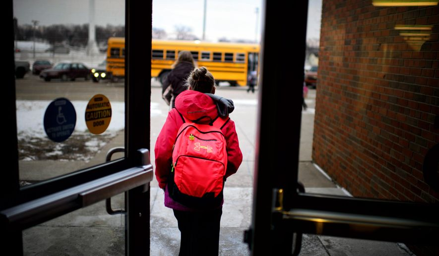 MACCRAY students head to the busses at four o'clock at the end of the day, Dec. 18, 2014. A fight is brewing here in this small pocket of southwestern Minnesota between a handful of rural school districts and the state. At issue is control over their innovative four-day school week, a popular schedule with both students, parents and teachers. Born out of financial necessity during leaner times, the four-day calendar has saved rural schools money on busing, heating and other administrative costs. School education officials, however, have ordered districts such as Maynard-Clara City-Raymond in west central Minnesota. (AP Photo/The Star Tribune, Glen Stubbe) ST. PAUL PIONEER PRESS OUT, MINNEAPOLIS-AREA TV OUT, MAGS OUT