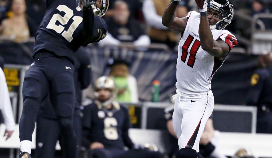 New Orleans Saints cornerback Patrick Robinson (21) leaps to defend a reception by Atlanta Falcons wide receiver Julio Jones (11) in the second half of an NFL football game in New Orleans, Sunday, Dec. 21, 2014. (AP Photo/Rogelio Solis)