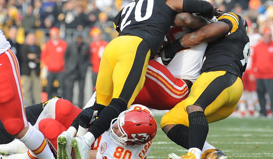 Kansas City Chiefs quarterback Alex Smith (11) is sacked on a fourth down by Pittsburgh Steelers outside linebacker James Harrison, right, and Will Allen (20) during the first half of an NFL football game in Pittsburgh, Sunday, Dec. 21, 2014. (AP Photo/Don Wright)