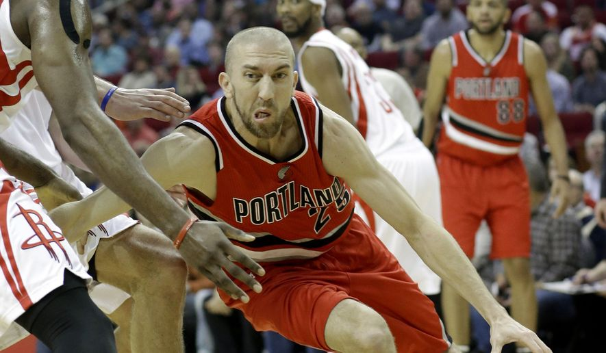Portland Trail Blazers' Steve Blake, right, drives the ball past Houston Rockets' James Harden, left, in the first half of an NBA basketball game Monday, Dec. 22, 2014, in Houston. (AP Photo/Pat Sullivan)