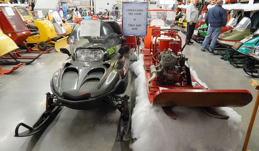 """In a Dec. 10, 2014 photo, the Top of the Lake Snowmobile Museum, located just off US-2 in Naubinway, Mich., features 80 different brands of snowmobiles and nearly 150 displays - like this """"Then and Now"""" feature which showcases past and present designs. Of the old machines represented, many are one-of-a-kind creations _ either special prototypes or homemade machines by barnyard engineers. (AP Photo/The Evening News, Scott Brand)"""