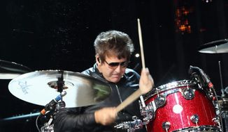 """Clem Burke performs with Blondie an Austin showcase at the 2014 SXSW Music, Film and Interactive Festival. Mr. Burke said, """"The Blondie thing is like being on a luxury pleasure cruise"""" when compared to traveling in a van with Empty Hearts. (Associated Press)"""