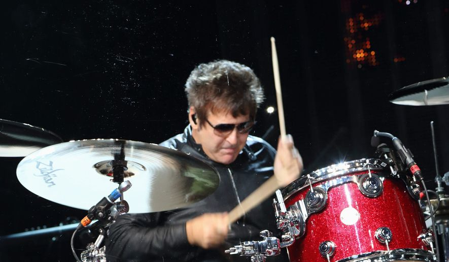 "Clem Burke performs with Blondie an Austin showcase at the 2014 SXSW Music, Film and Interactive Festival. Mr. Burke said, ""The Blondie thing is like being on a luxury pleasure cruise"" when compared to traveling in a van with Empty Hearts. (Associated Press)"