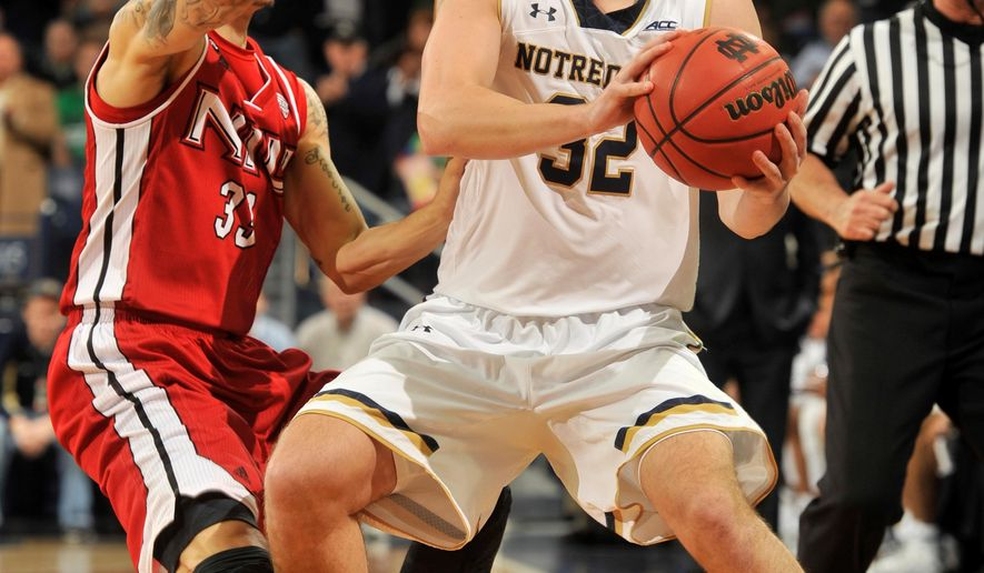 Notre Dame guard Steve Vasturia, right, prepares to throw a pass around Northern Illinois guard Anthony Johnson during the first half of an NCAA college basketball game Monday, Dec. 22, 2014, in South Bend, Ind. (AP Photo/Joe Raymond)