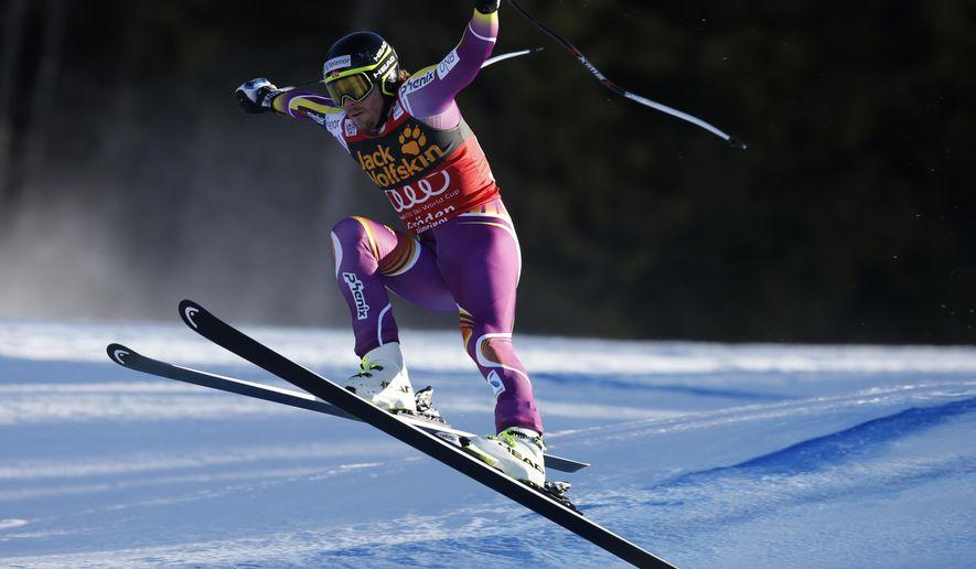 Kjetil Jansrud, of Norway, skies on his way to victory in an alpine ski, men's World Cup Super-G in Val Gardena, Italy, Saturday, Dec. 20, 2014. (AP Photo/Armando Trovati)