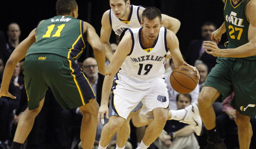 Memphis Grizzlies' Beno Udrih (19) looks for an opening past Utah Jazz's Dante Exum (11) in the first half of an NBA basketball game Monday, Dec. 22, 2014, in Memphis, Tenn. (AP Photo/Karen Pulfer Focht)