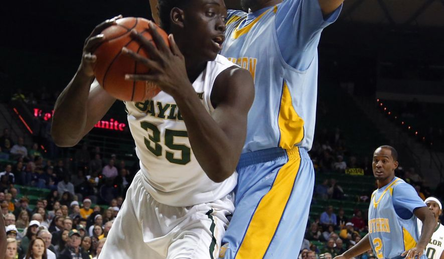 Baylor forward Johnathan Motley, left, drives around Southern guard Adrian Rodgers during the first half of an NCAA college basketball game, Monday, Dec. 22, 2014, in Waco, Texas. (AP Photo/Rod Aydelotte)