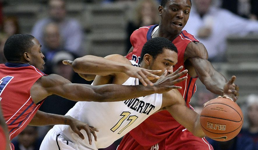 Vanderbilt forward Jeff Roberson (11) tries to drive between Penn defenders Tony Hicks, left, and Greg Louis during the first half of an NCAA college basketball game Monday, Dec. 22, 2014, in Nashville, Tenn. (AP Photo/Mark Zaleski)