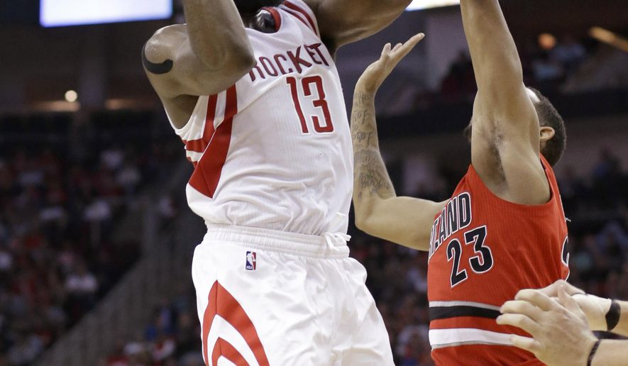 Houston Rockets' James Harden (13) shoots over Portland Trail Blazers' Allen Crabbe (23) in the second half of an NBA basketball game Monday, Dec. 22, 2014, in Houston. The Rockets won110-95. (AP Photo/Pat Sullivan)