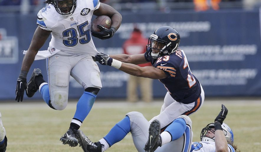 Detroit Lions running back Joique Bell (35) leaps as Chicago Bears cornerback Kyle Fuller (23) grabs him in the second half of an NFL football game Sunday, Dec. 21, 2014, in Chicago. The Lions won 20-14. (AP Photo/Nam Y. Huh)