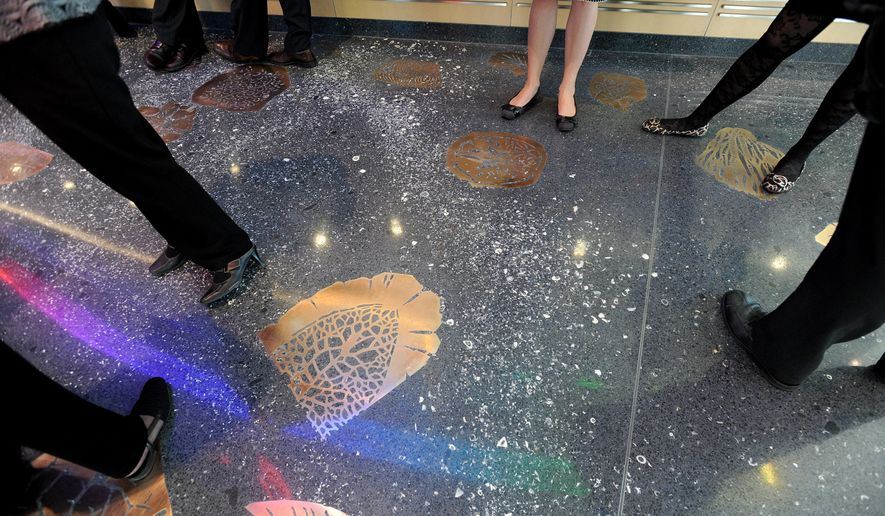 This undated photo shows the fossil terrazzo floor in the inside the lobby of the new C.S. Mott Children's Hospital in Ann Arbor, Mich. An app featuring a bronze fossil floor at the main entrance of the building allows patients to take virtual prehistoric journey. (AP Photo/AnnArbor.com, Angela J. Cesere) LOCAL TV OUT; LOCAL INTERNET OUT