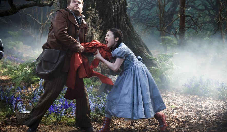 """In this image released by Disney Enterprises, Inc., James Corden, left, and Lilla Crawford as Little Red Riding Hood appear in a scene from """"Into the Woods.""""  (AP Photo/Disney Enterprises, Inc., Peter Mountain)"""