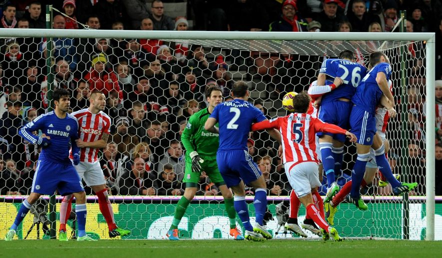 Chelsea's John Terry (26) heads the ball to score against Stoke during the English Premier League soccer match between Stoke City and Chelsea at the Britannia Stadium, in Stoke on Trent, England, Monday, Dec. 22, 2014. (AP Photo/Rui Vieira)