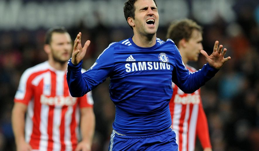 Chelsea's Cesc Fabregas celebrates after scoring against Stoke during the English Premier League soccer match between Stoke City and Chelsea at the Britannia Stadium, in Stoke on Trent, England, Monday, Dec. 22, 2014. (AP Photo/Rui Vieira)
