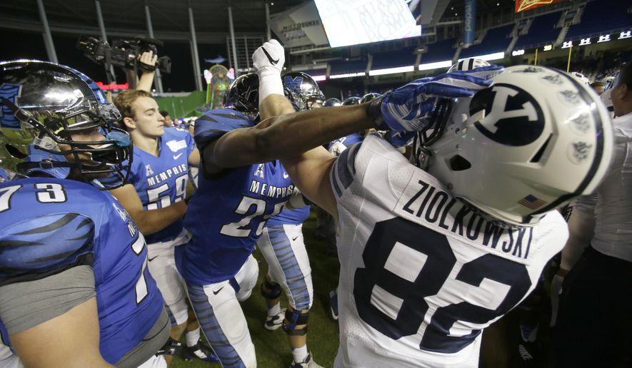 Players scuffle after Memphis defeated Brigham Young, 55-48 in double overtime during the inaugural Miami Beach Bowl football game, Monday, Dec. 22, 2014 in Miami. (AP Photo/Wilfredo Lee)