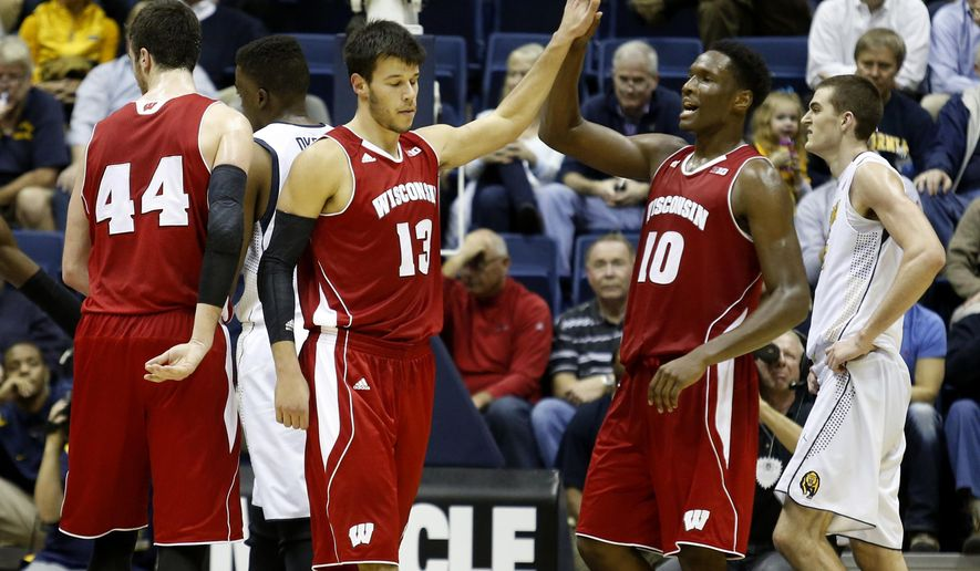 Wisconsin forward Nigel Hayes, right, and forward Duie Dukan, left, celebrate during the first half of an NCAA college basketball game in Berkeley, Calif., Monday, Dec. 22, 2014. (AP Photo/Beck Diefenbach)