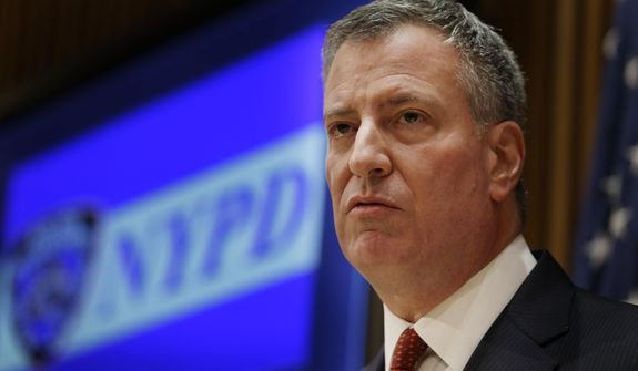 New York City Mayor Bill de Blasio listens during a news conference at police headquarters in New York, Monday, Dec. 22, 2014. (AP Photo/Seth Wenig)