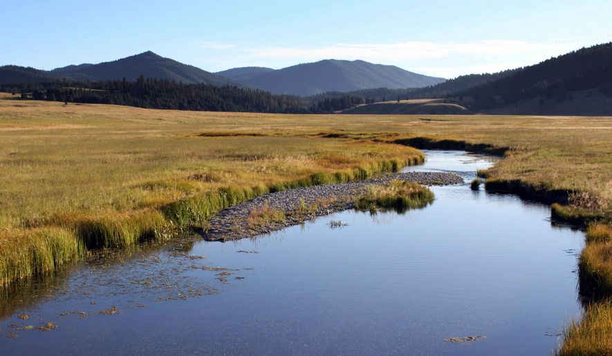 FILE - In this Sept. 3, 2010 file photo, the East Fork of the Jemez River cuts through Valles Caldera National Preserve, N.M. The National Park Service is preparing to take over the 140-square-mile preserve under legislation signed by President Barack Obama on Friday, Dec. 19, 2014. (AP Photo/Susan Montoya Bryan,File)